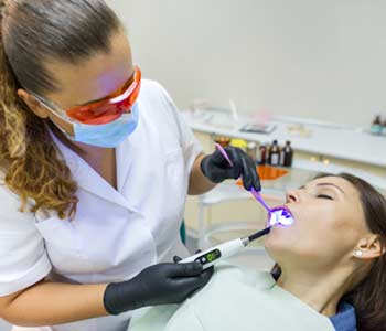 Dentist doing a dental tratment for a lady patient by using sedation treatment